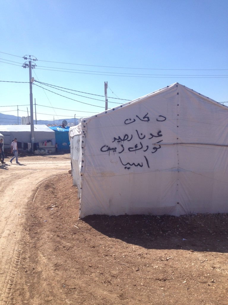 Writing on this tent in Dawodiya IDP camp, advertises that they sell credit for Korek, Zain and Asiacell, the three mobile network operators in Iraq.