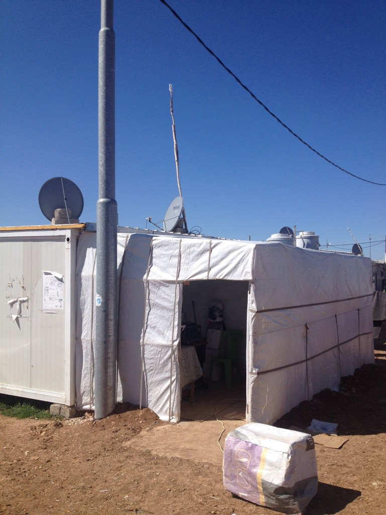Above the satellite dish on this house in Dawodiya IDP camp, Dohuk governorate, is a small wifi device on a stick, protected from rain and snow by an improvised cover made from a water bottle.