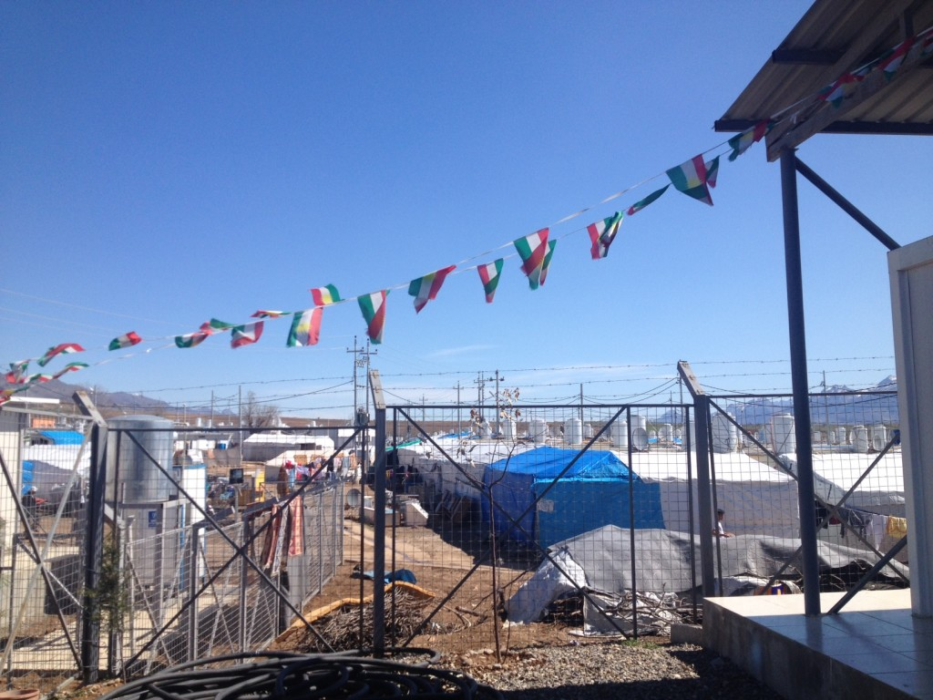 Kurdistan flags flying outside the camp administration building, Dawodiya camp, Dohuk governorate.