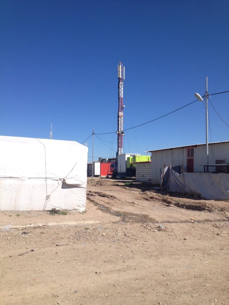 Cellular network tower in Domiz refugee camp.