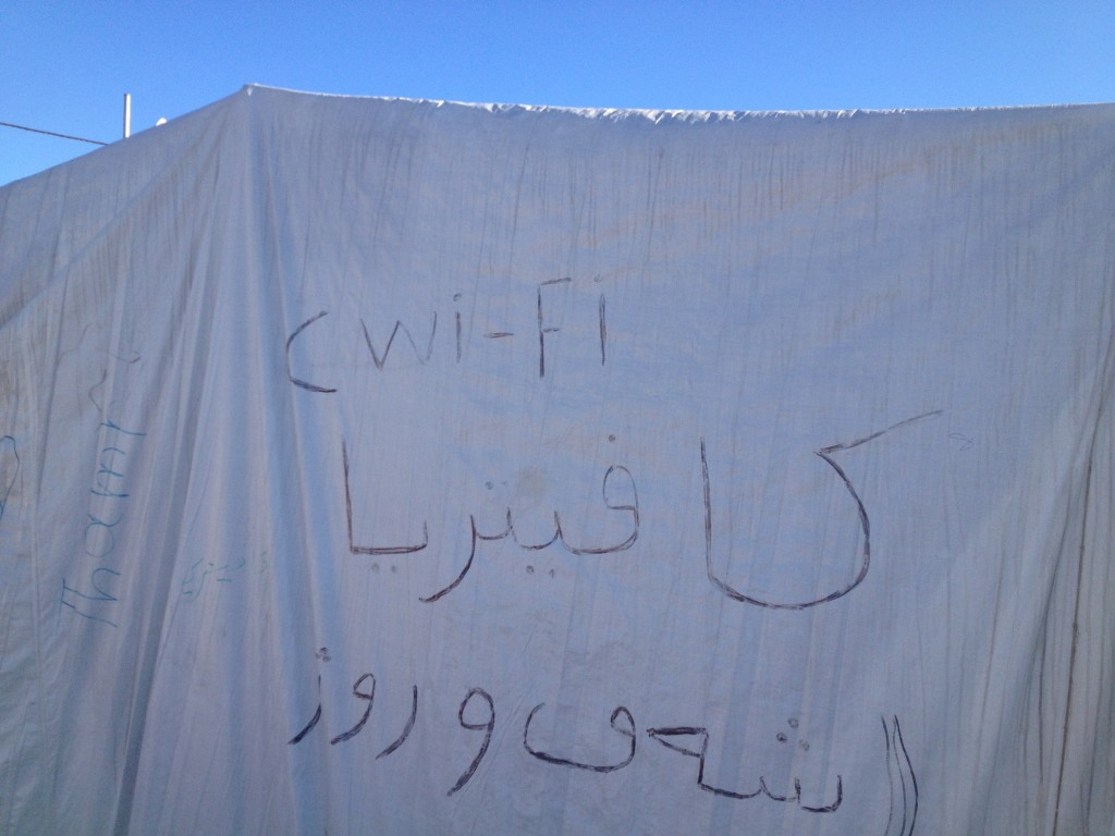 Writing on the side of an internet cafe tent in Khanke IDP camp advertising that it is a 'wifi cafeteria'.
