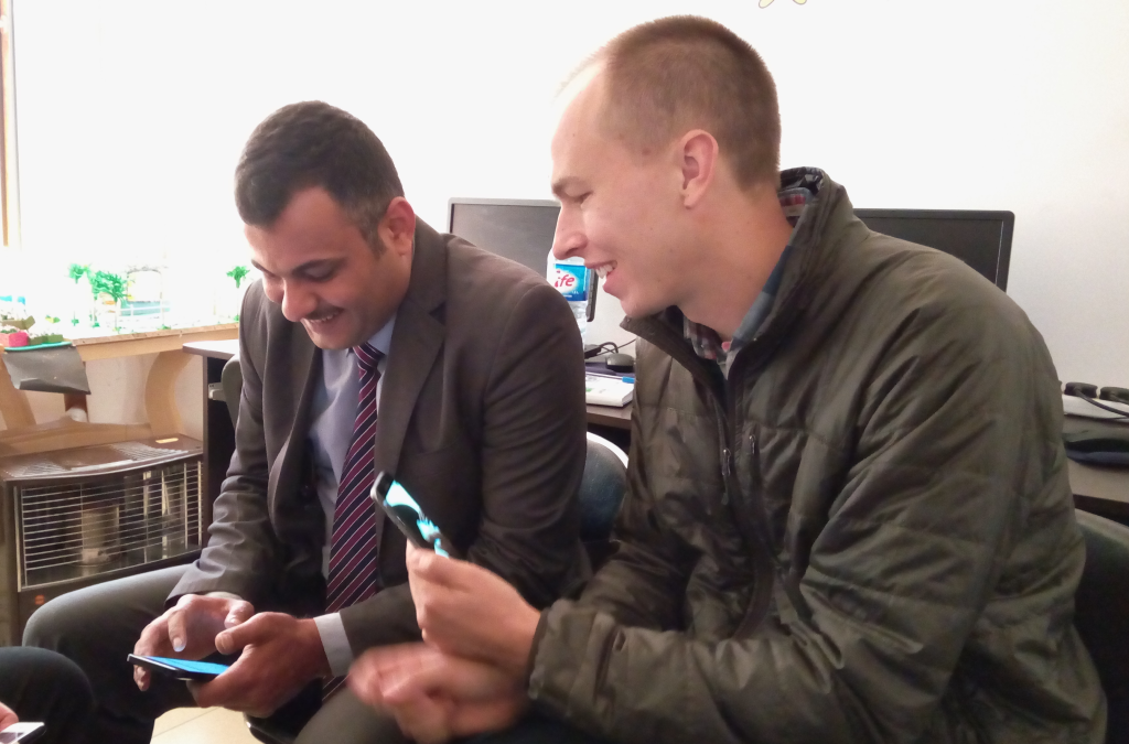 REFUNITE Product Manager Vytas Bradunas uses his phone to record a usability test with Mohammed, displaced from Anbar governorate.