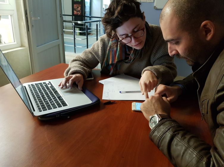 Middle East Project Manager Sacha Robehmed and one of the site's translators, Re:coded fellow Omar*, reviewing translations.